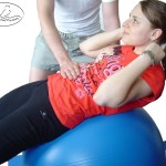 Exercise for abdominal muscles on the Swiss ball.